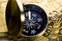 World map on old compass Stock Photos