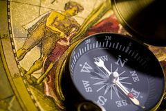 World map on old compass Stock Photo