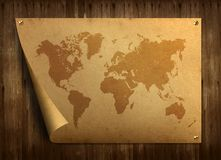 World map on old paper. Stuck on the old wooden floor stock photos