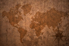 World map on a old vintage crack paper background Stock Photo