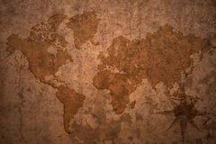 World map on a old vintage paper background Royalty Free Stock Image