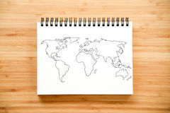 World map outline on notebook Royalty Free Stock Photo