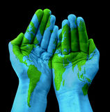 World map painted on human hands Royalty Free Stock Photography
