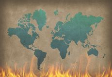 World in fire. World map. Painting in blue color on the burning wall. 3D rendering Royalty Free Stock Images