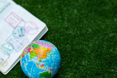 World map and passport. Asia World map on a ball and passport stock image