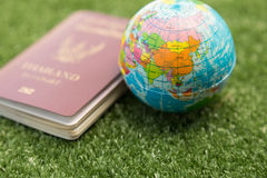 World map and passport. Asia World map on a ball and passport stock photos