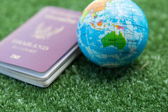 World map and passport. Australia World map on a ball and passport stock images