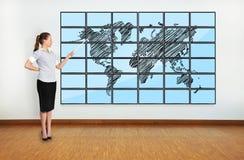 World map on plasma. Businesswoman pointing at world map on plasma Royalty Free Stock Photography