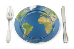 World Map on a plate with fork and knife. International cuisine Stock Image