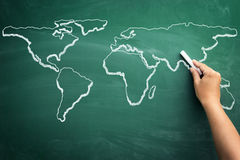 World map on a school blackboard royalty free stock images