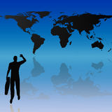World map and silhouette background. Silhouette of a young business man carrying a briefcase in front of a world map Stock Photography