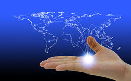World map social network hovering in a hand royalty free stock photo