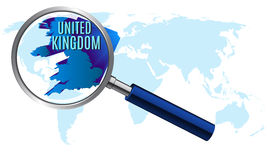 World map with united kingdom magnified by loupe Royalty Free Stock Images