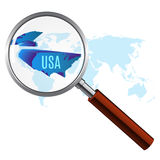World map with usa magnified by loupe Royalty Free Stock Images