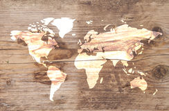 World map on wooden background Stock Images