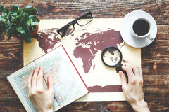 World map on a wooden table with girl hands Royalty Free Stock Photos