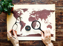 World map on a wooden table Royalty Free Stock Image