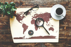 World map on a wooden table top view Royalty Free Stock Photos