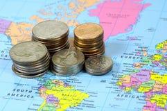 World Market. Coins and a World Map stock photos