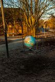 The world may swing. Globe put on a playground swing, representing a fine balance royalty free stock photos