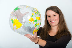 The world is me. Young woman has the world in her hands Royalty Free Stock Images