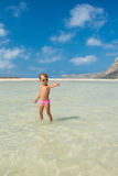The world is mine. Child is standing in the sea water and points the finger forward Stock Image