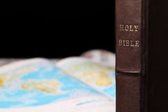 World missions. Holy Bible and a world map in the background. World missions concept. Copy space Stock Photo
