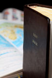 World missions. Holy Bible and a world map in the background. World missions concept. Copy space Stock Image