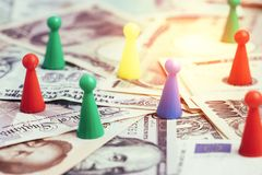 World money tariff trade war, colorful plastic game figurines on. International major countries banknotes, US dollar, Japanese yen, Euro, Chinese yuan Stock Photo