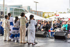 World of Montgomery  2015 Festival. Maryland, USA - Oct.18,2015: People watching children singing on stage at the 7th Annual World of Montgomery 2015 Festival Royalty Free Stock Photo