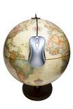 World is a mouse click away. Metallic computer mouse hanging on an earth globe Stock Photo