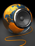 World music. Abstract 3d illustration of earth globe with audio speaker inside Stock Image