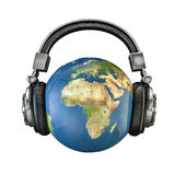 World music. 3D render of planet Earth with headphones, Earth map texture source: cinema4dtutorial.net Royalty Free Stock Photos