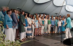 World Music Choir performing live. On the Global Community Stage at the Exeter Respect Festival 2012 Stock Photography