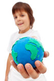 The world in my hand - young boy holding earth globe Stock Image