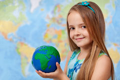 The world in my hands - little girl in geography class Stock Photo
