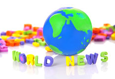 WORLD NEWS. Toy letters and a globe Royalty Free Stock Image