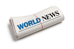 World News. Newspaper roll with white background Stock Photography