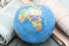 World news. Picture of a terrestrial globe over some newspapers Royalty Free Stock Image