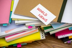 World News; The Pile of Business Documents on the Desk Stock Photos