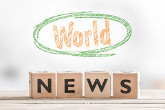 World news sign on a table. World news sign on a wooden indoor table Royalty Free Stock Photography
