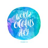 World oceans day emblem - brush calligraphy on a watercolor planet earth. Vector illustration Stock Photo