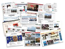 World online newspapers in a pile detail of newspapers with news information and reading Stock Images