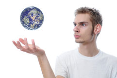 The World Is In Our Hands. Young adult white Caucasian man ponders the planet Earth Royalty Free Stock Image