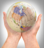 The world in our hands stock image