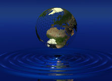 World over Water. World Globe suspended of water ripples Stock Image