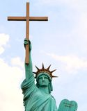 World Overcomers Outreach Ministries Church Statue of Liberty. A Memphis-area megachurch has erected a Statue of Liberty lookalike -- holding a cross instead of Royalty Free Stock Photo