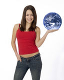World in the Palm of Her Hand. Young woman standing holding planet earth in the palm of her hand Stock Image