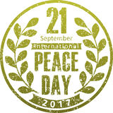 2017 World Peace Day design with olive wreath in grunge style. 2017 World Peace Day design with olive wreath in grunge style Stock Image