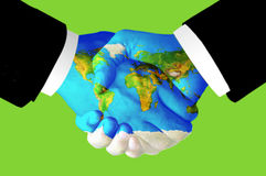 World Peace Handshake. Picture of two hands shaking for world peace and harmony Stock Image